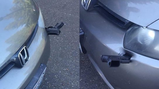 gun car bumper, handgun lodges into bumper