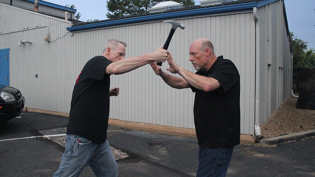 Shoulder Stop, self-defense, hammer, step 2