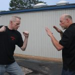 Shoulder Stop, self-defense, punch, step 1