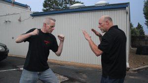 Shoulder Stop, self-defense, punch, step 1