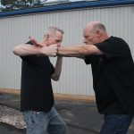 Shoulder Stop, self-defense, punch, step 3
