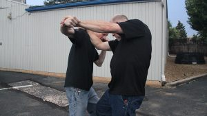 Shoulder Stop, self-defense, punch, step 4