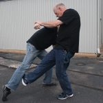 Shoulder Stop, self-defense, punch, step 5