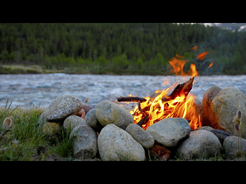 Place rocks around your survival campfire.