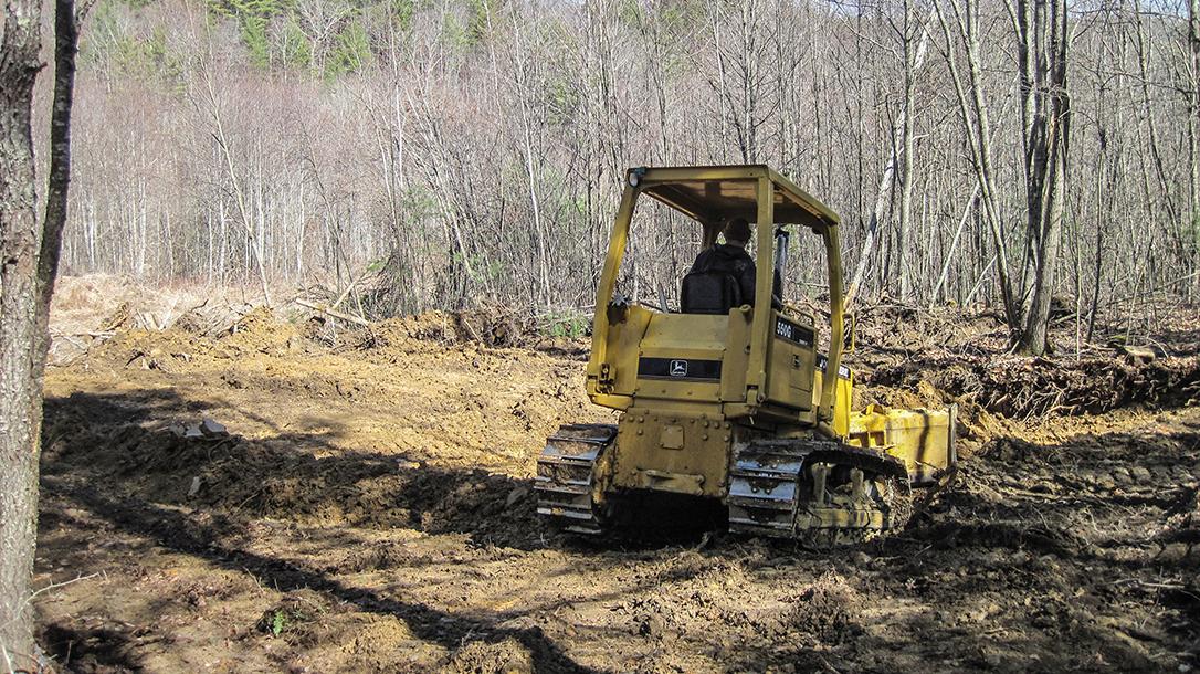DIY Backyard Shooting Range, clearing land, bulldozer