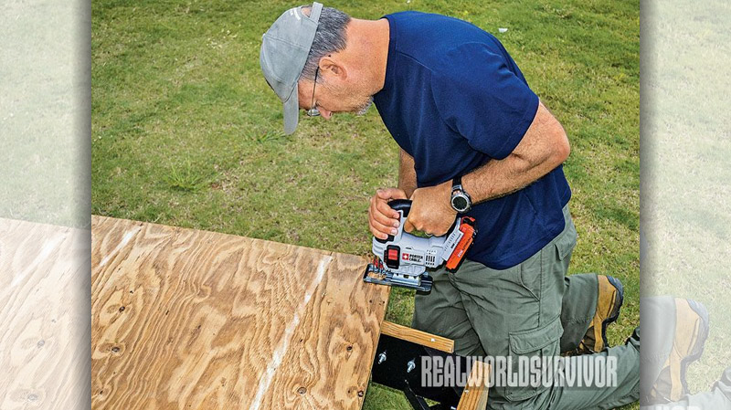 A jigsaw makes fitting the plywood floor into the frame easy.