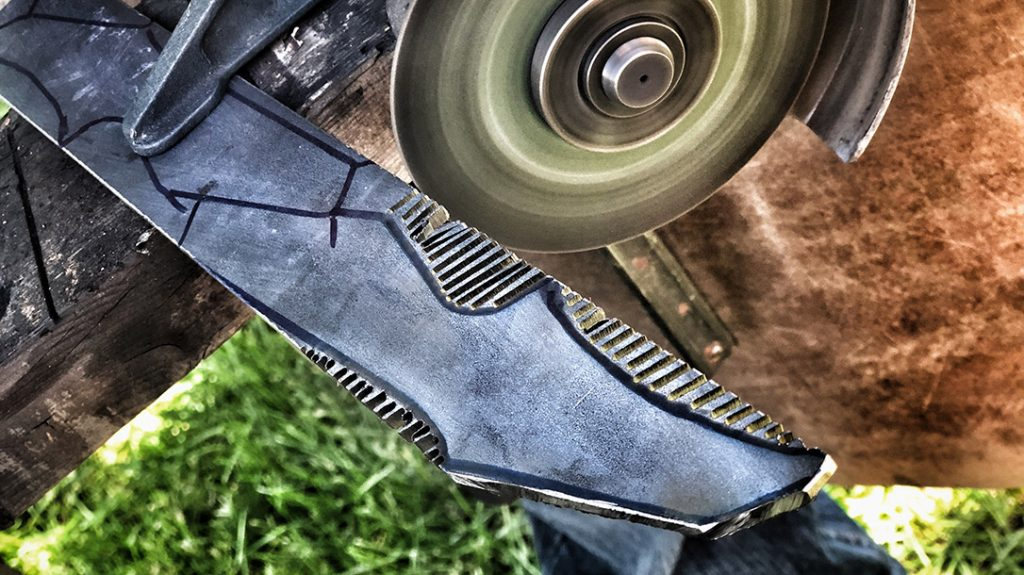 Then, using an angle grinder, they cut out the rough shape of the blade.