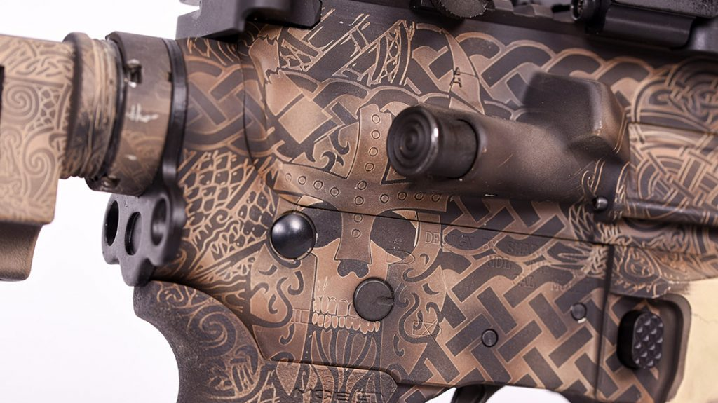 Attention to detail on the right side of the rifle is exquisite, from draug to knotwork.