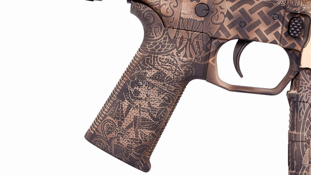 Don't forget about the pistol grip. Odin's Workshop's continuation of the art from the receiver to the grip is seamless!