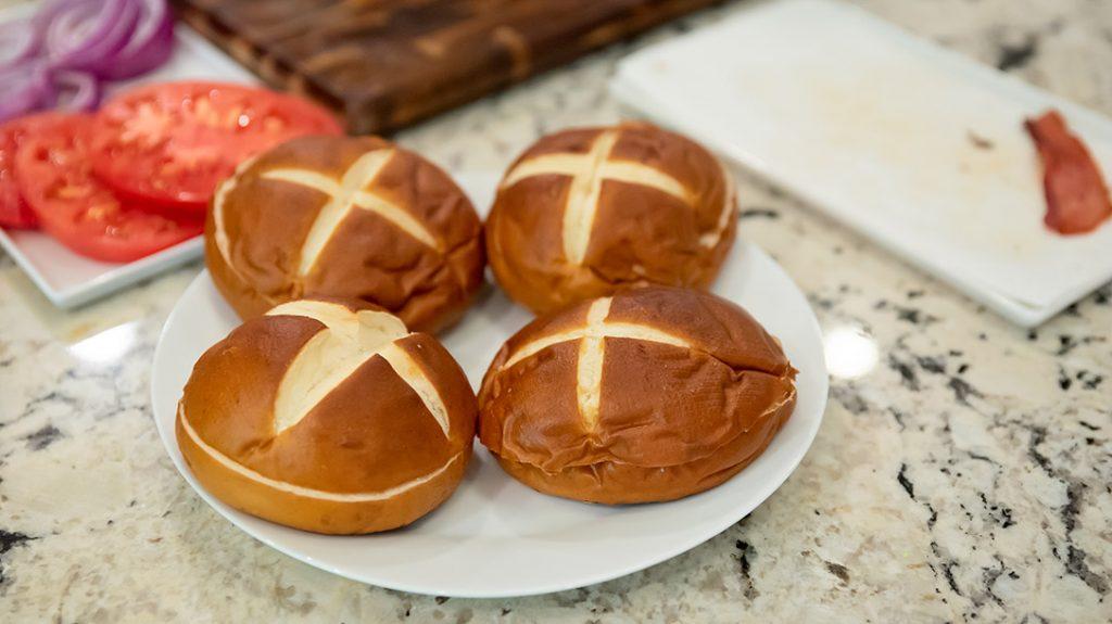 Prepare your pretzel buns to receive the burgers.