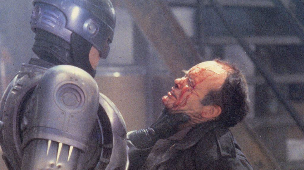 Robocop dealing a beatdown to a bad guy.