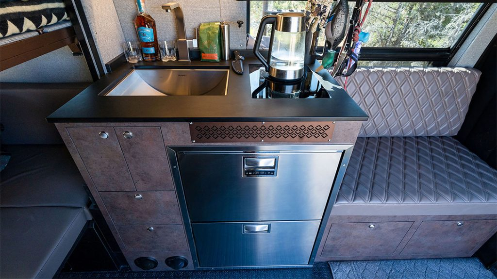 The custom galley kitchen of the Outside Van Launch Pad is the perfect size for whipping up a quick meal.