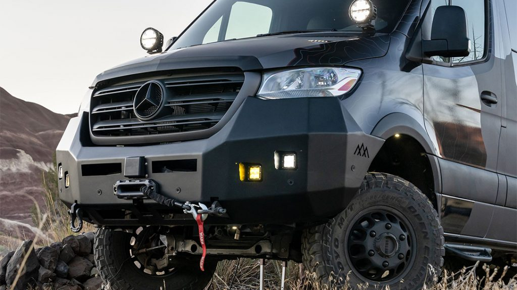 Backwoods Bumper with Warn Zeon 12-S Platinum Winch ensures the Outside Van Launch Pad will not stay stuck for long.