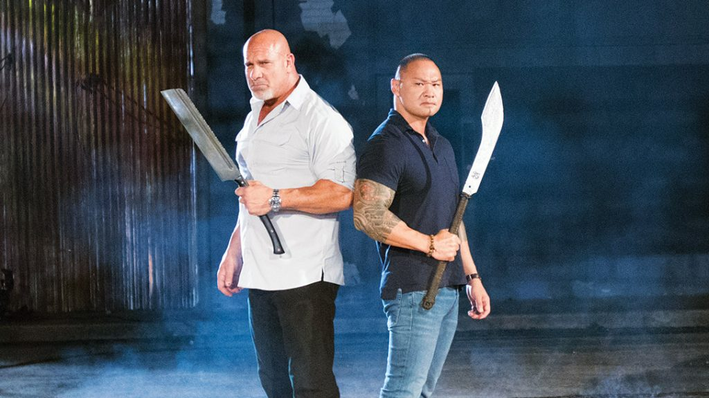 Tu Lam and Bill Goldberg on the set of their show Forged in Fire: Knife or Death.