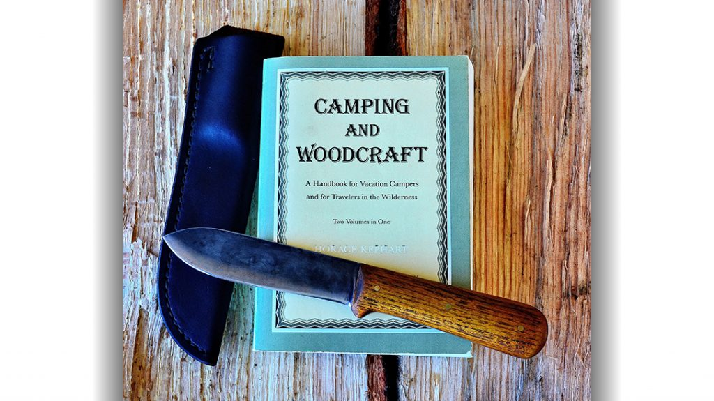 The Kephart knife is one of the most replicated designs in the industry. It is pictured here with Kephart's popular book, Camping and Woodcraft.