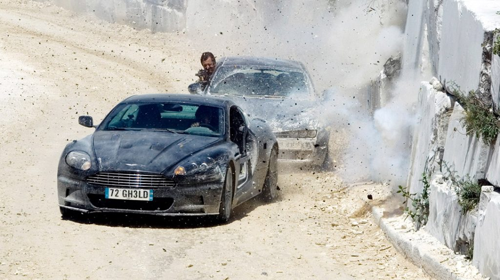 Would James Bond win in a car chase vs John Wick?