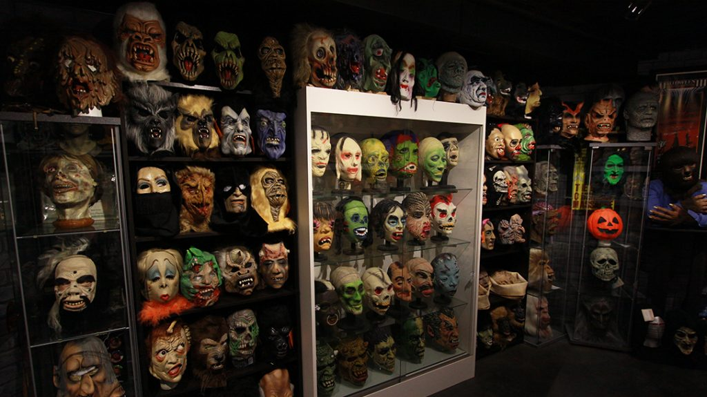 Rudy Munis, collector, masks, wall