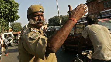 Policeman directs traffic