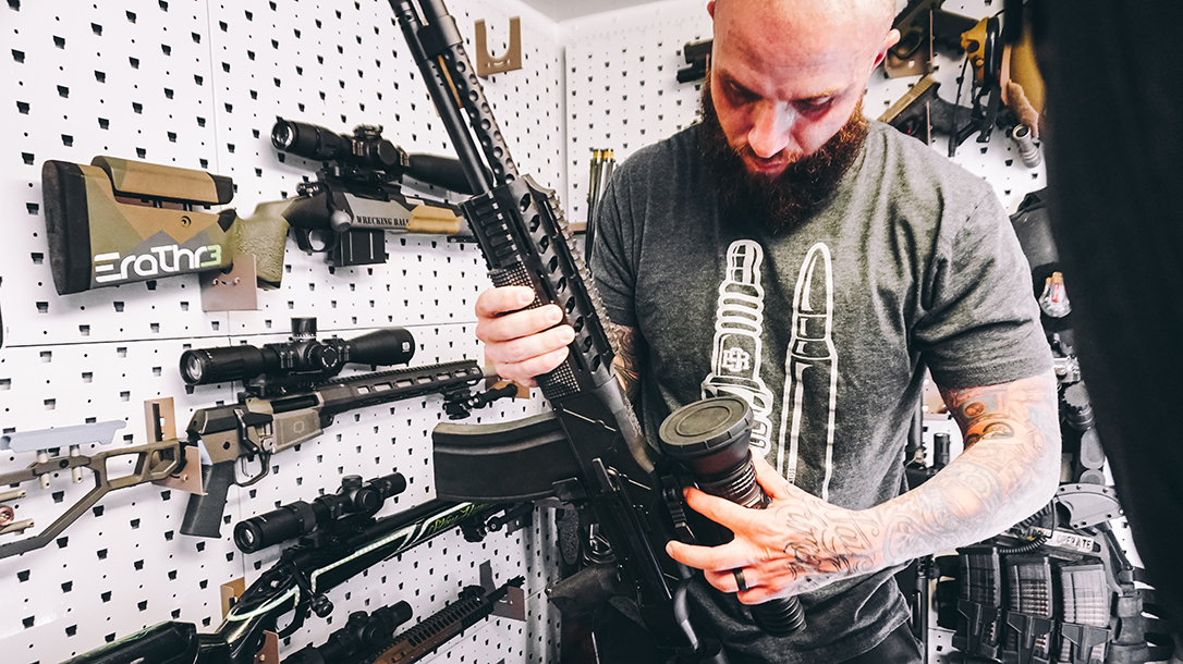 Austin Weiss with his collection of guns.