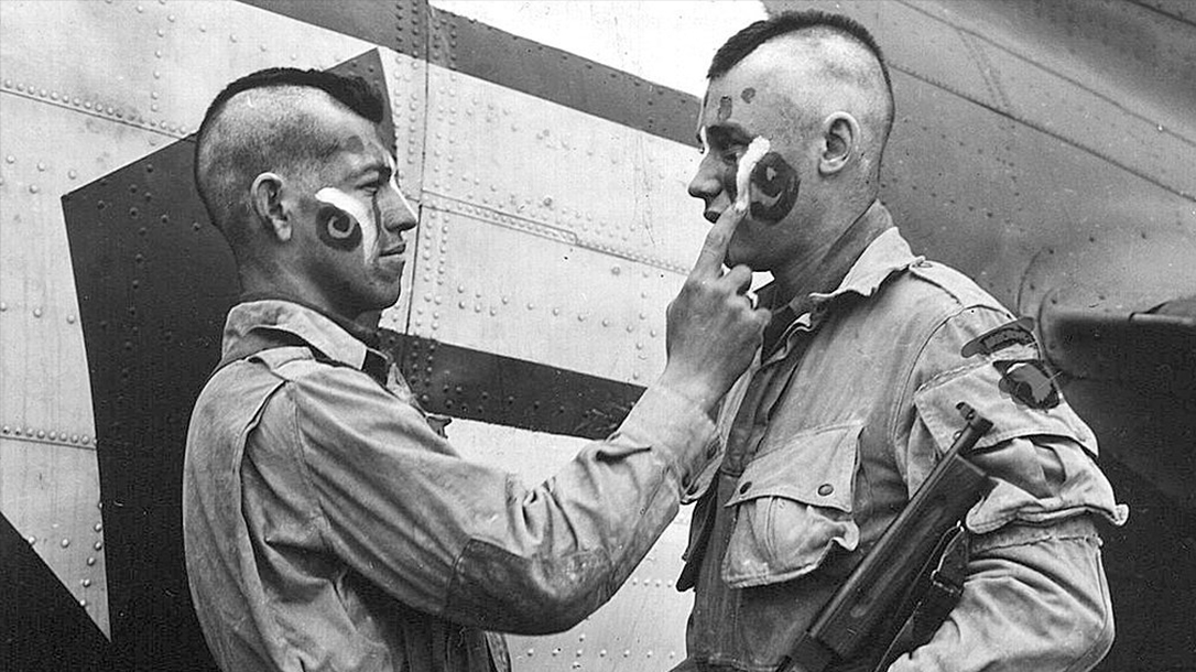 Filthy Thirteen soldiers putting on war paint.