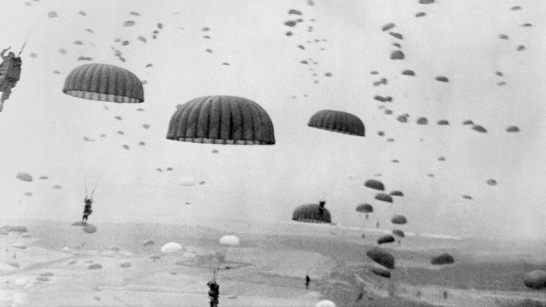 Army soldiers under canopy during the invasion.
