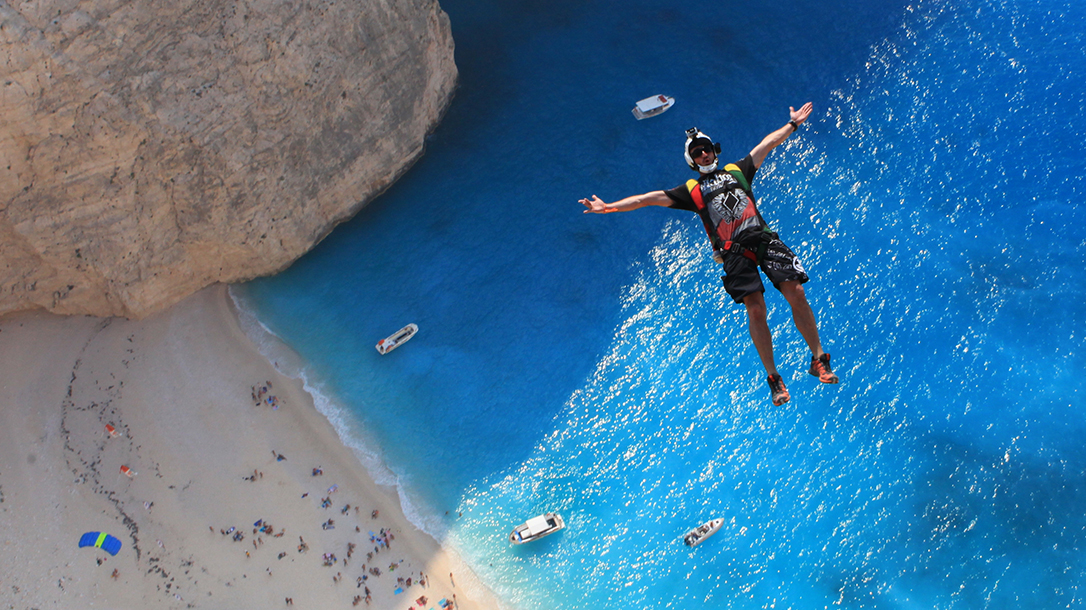 Carlos base jumping over the beach.
