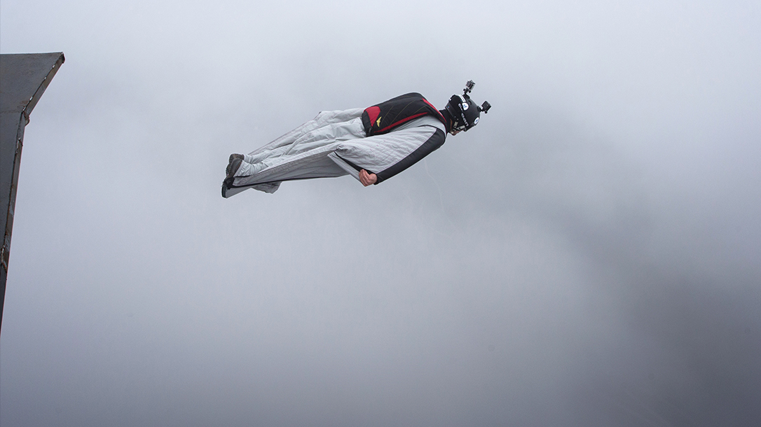 Carlos Pedro Briceño above the clouds in a wingsuit.