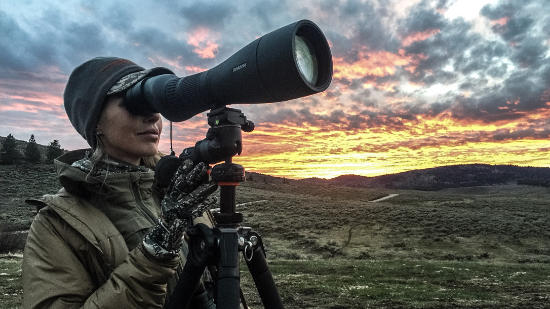 Julie looking through a scope.