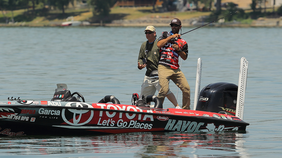 Mike Iaconelli on his bass boat in a competition.