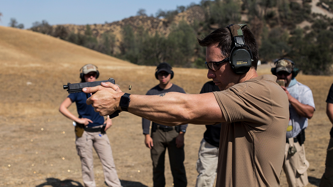 Travis giving a class on the range.