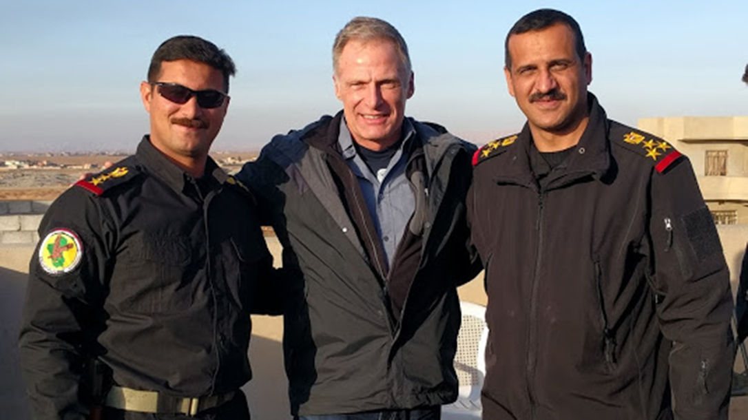 Caption: Col. Arkan (left), the author and Brig. Gen. Haider at the forward command post in Mosul.