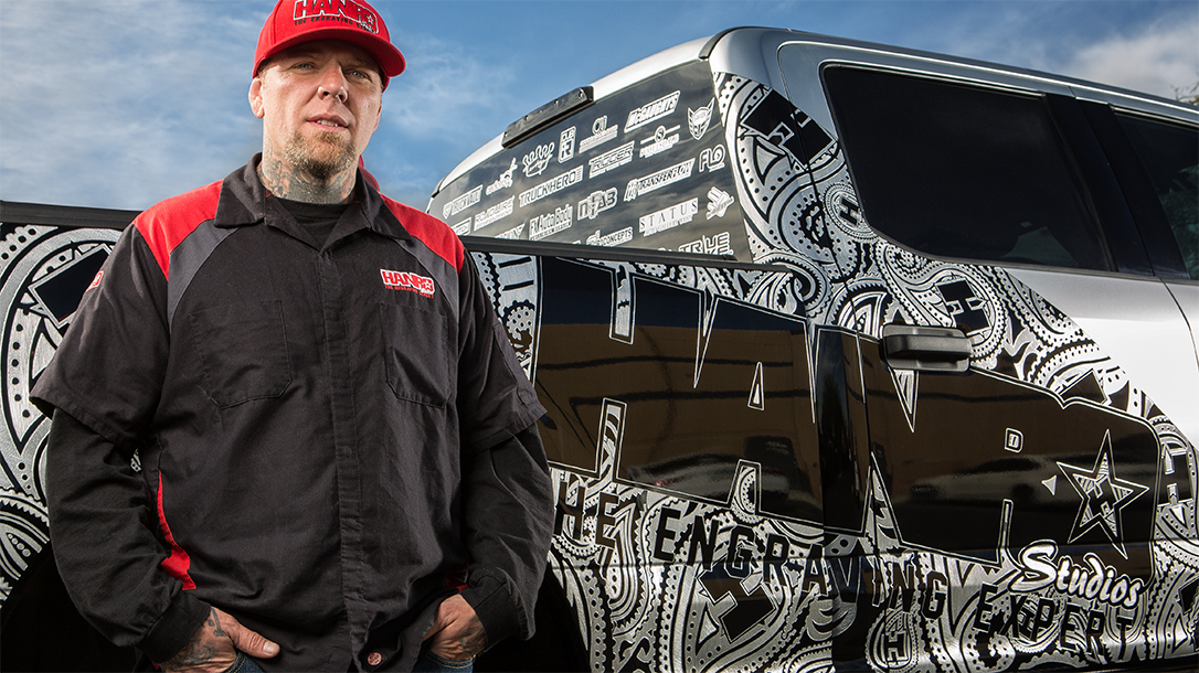 Combat veteran and master engraver Hank Robinson in front of his truck.