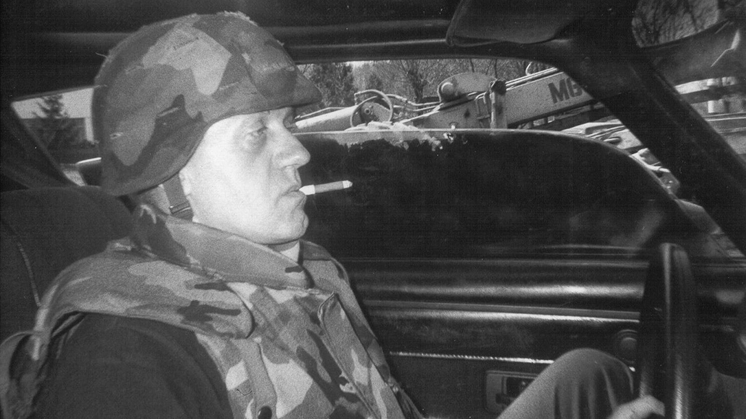 Helge in the front seat of his war Camaro.