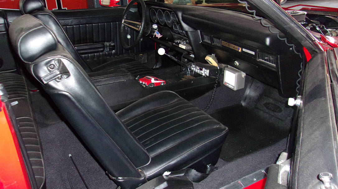The interior of this 70s muscle car has all the creature comforts of the era two cops might need.