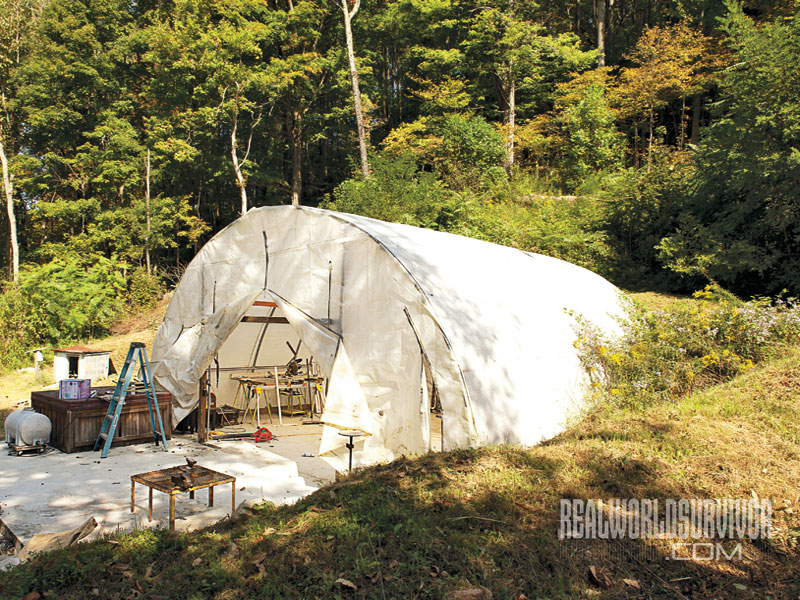 Steve's hoophouse last fall before he finished it. This winter he closed it up so the air inside could supplement the geothermal heat going into the containers.