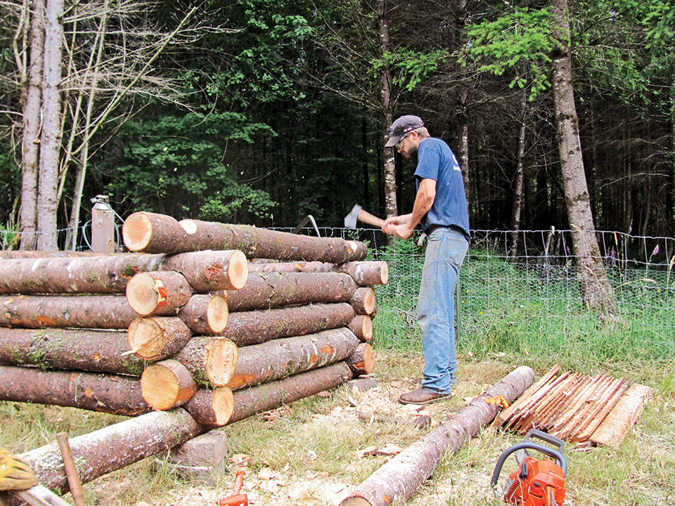 3.-Notching-logs-for-the-shower-shack