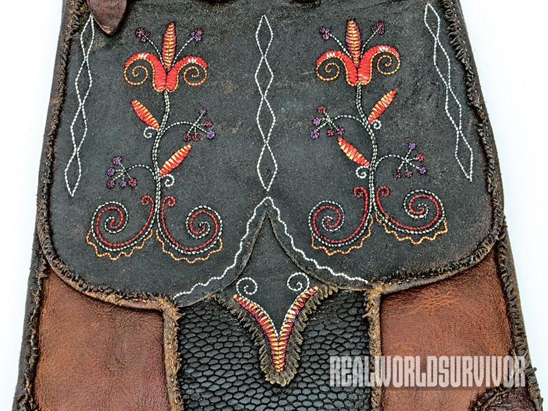 Shawn Webster made a quill-embroidered panel of brain- tanned buckskin hunting bag.