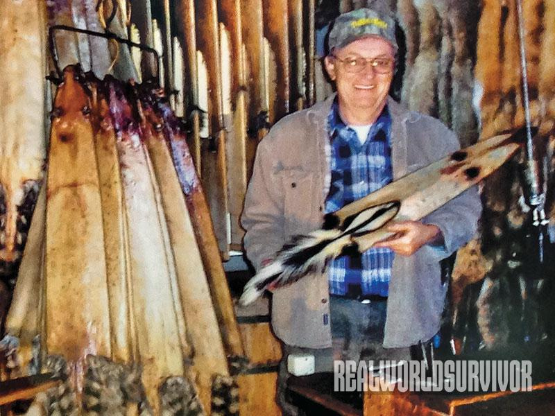 The curator of the Trap History Museum holds up fur from animals he trapped in 2012