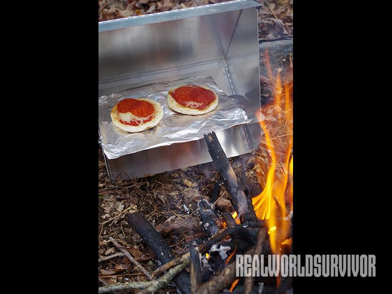 Mini pizzas made in a reflector oven.