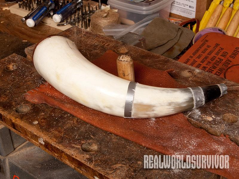 Step one to create your powder horn is to divide the horn into the neck and the body using tape.