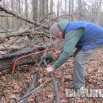 Cut a ridge pole with a bow saw.