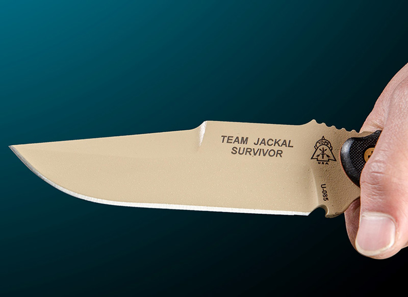 TOPS Knives' Team Jackal Survivor has a Coyote Tan powder coat to protect the steel.