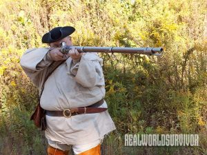 Author tries out musket replica.