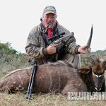 The author with his handgun and a nyala he topped.