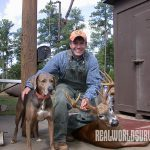 A happy hunter and his dog.