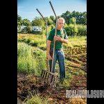 Craig Dambacher uses a broadfork on the farm.