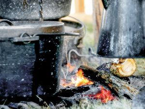 Dutch ovens can work in place of a modern stove.