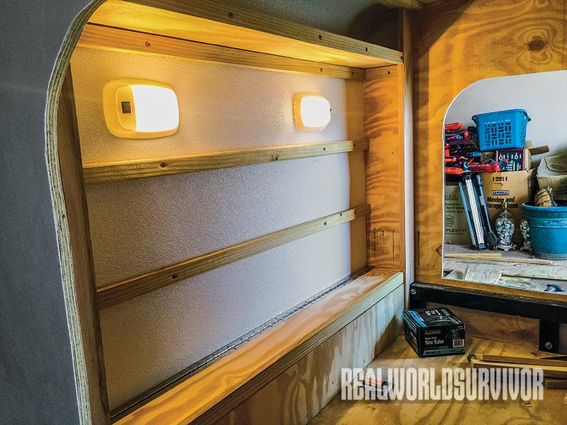 Keiper built shelves in the camper.