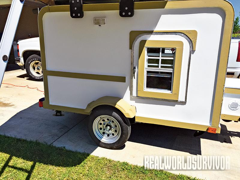 The side door of the camper offers easy access to the sleeping area.
