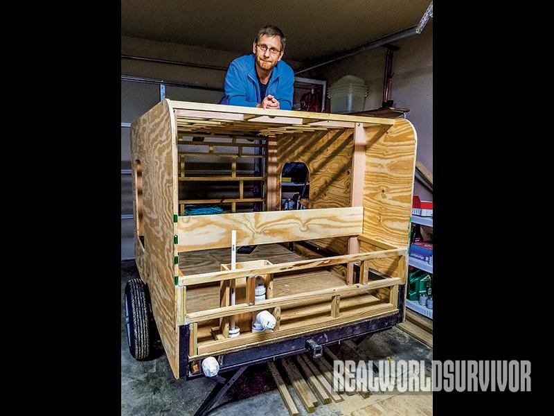 Eric Keiper tests the strength of the camper frame.